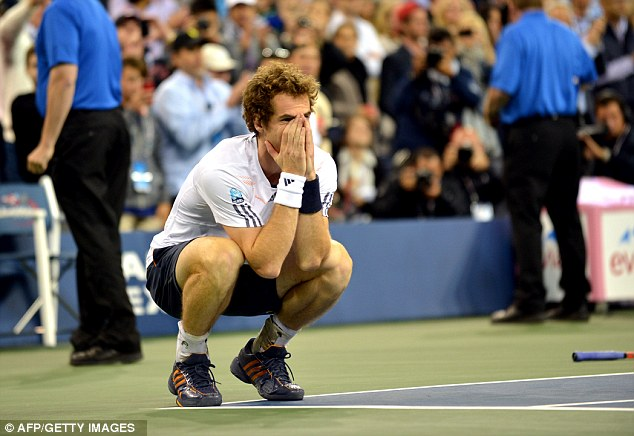 Historic moment: Murray sinks to the ground as he beats Novak Djokovic in the US Open final