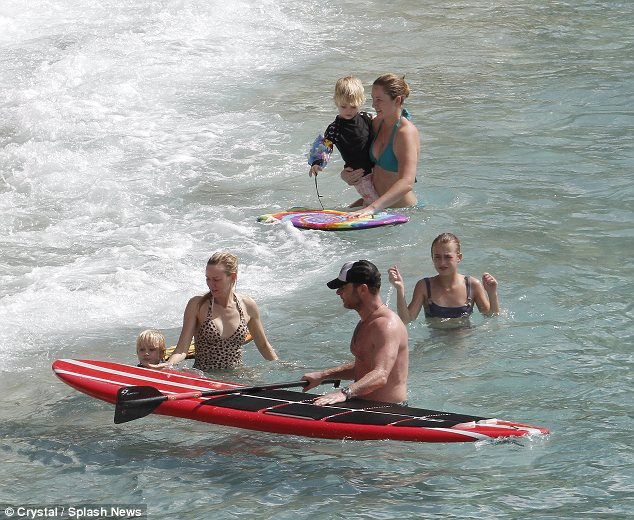 Making a splash: The family also enjoyed some paddle boarding
