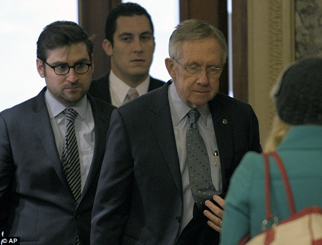 Talks: Senate Majority Leader Harry Reid of Nevada, right, arrives on Capitol Hill in Washington as fiscal cliff negotiations continued