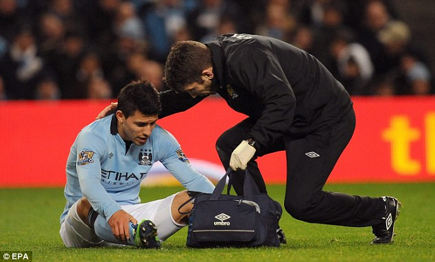 Soured: Manchester City's routine win over Stoke was marred by a hamstring injury to Sergio Aguero