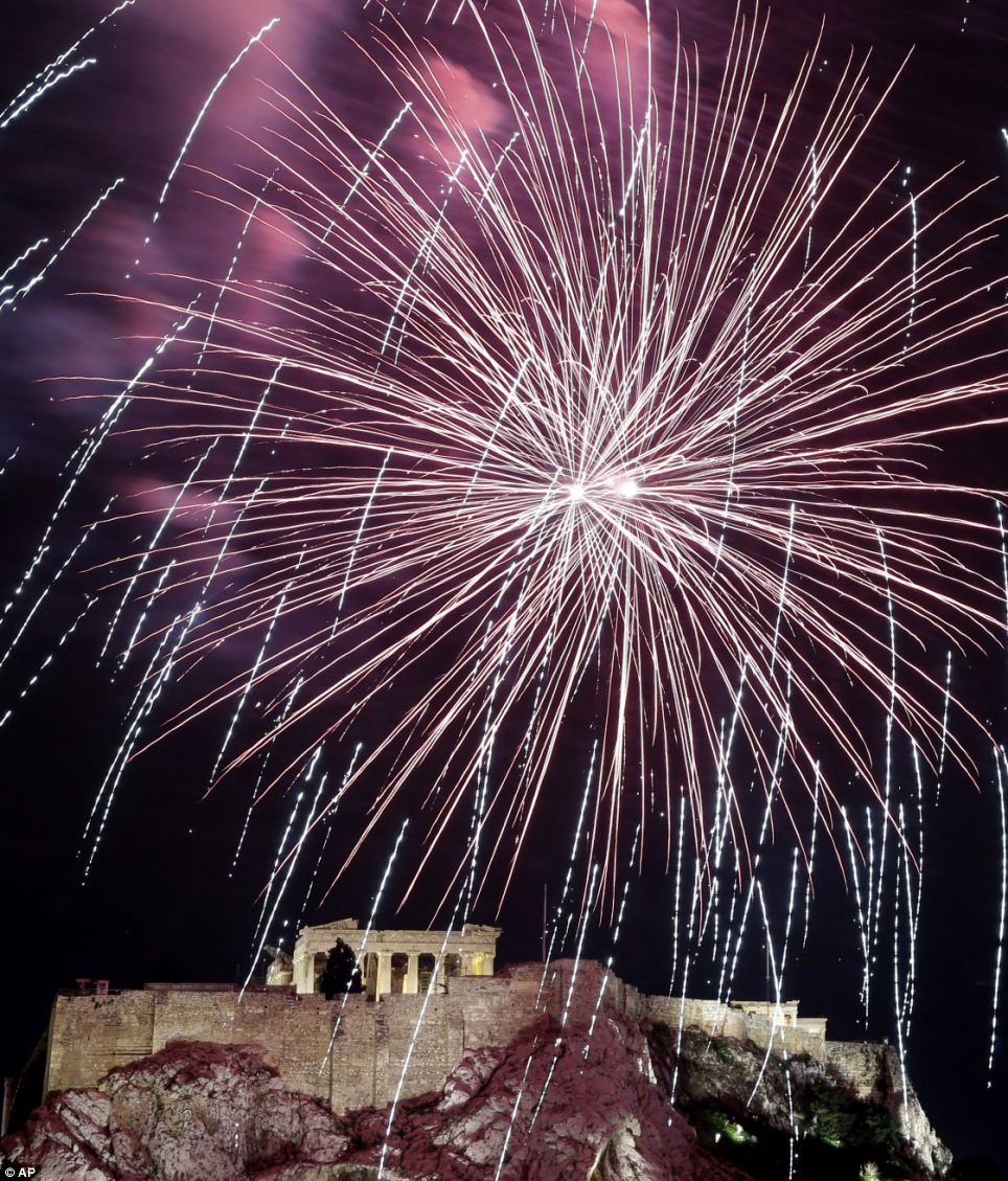 Fireworks explode over the ancient Acropolis Hill with the Parthenon temple during New Year's celebrations