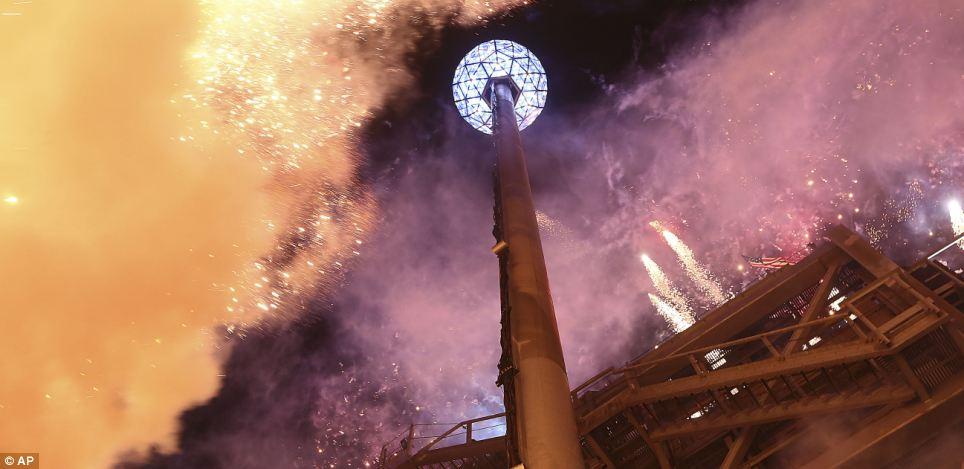 The fireworks explode as the Waterford crystal ball is raised at the beginning of Times Square's New Year's celebration earlier