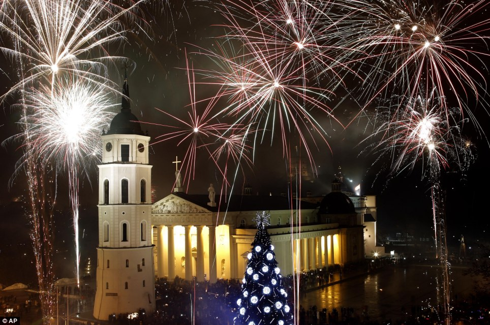 Fireworks light the sky above the Cathedral Square in the Lithuanian capital Vilnius