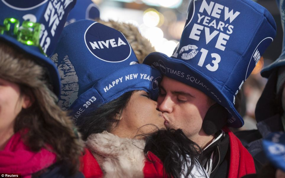 A couple kiss ahead of New Year celebrations at Times Square in New York