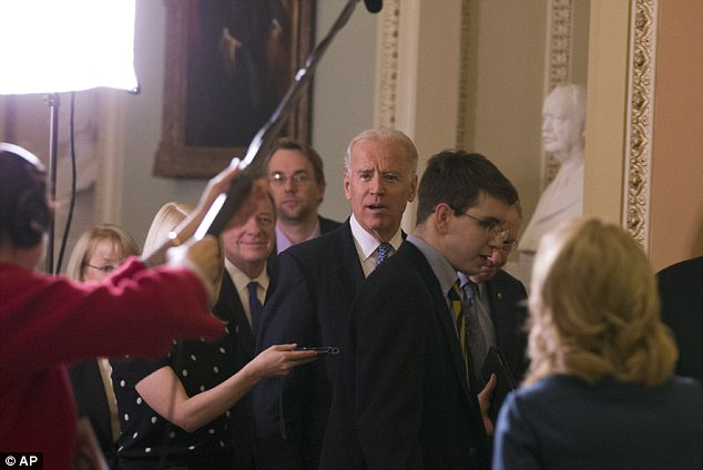 Arrival: Vice President Joe Biden, center, with Majority Leader Harry Reid of Nevada, and Majority Whip Dick Durbin of Illinois, head to a Senate Democratic caucus meeting about the fiscal cliff, shortly after the deal was announced