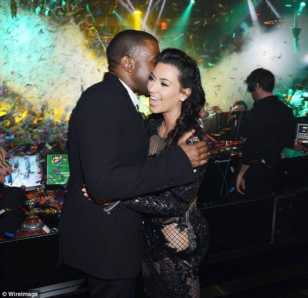 Ringing in the New Year: Kanye whispers in Kim's ear as the they countdown to 2013