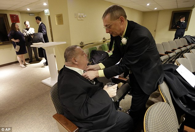 For better or worse: William Countryman, right, adjusts partner Roy Neal's tie before they tie the knot