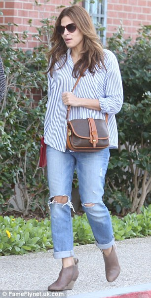 Hole-y moly: Eva was also spotted in Calabasas dressed in ripped jeans and a baggy striped shirt