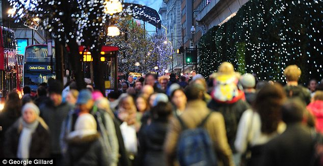 Discount frenzy: Shoppers scramble for perfume in Boxing Day sales; Christmas trading was ¿acceptable¿ but ¿not exceptional¿, the British Retail Consortium said