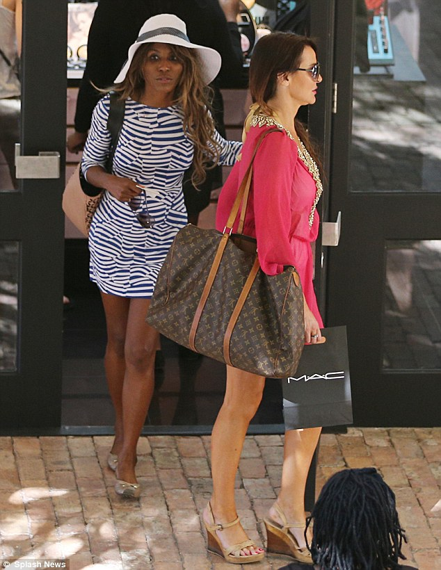 Hitting the shop: Lizzie squeezes in some time for some shopping with pal Sinitta in between all of her water sports