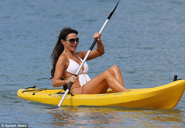 Fun in the sun: The model seems to be having a whale of a time as she makes the most of her holiday