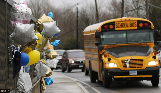 Never forget: One of the many memorials for the 20 Sandy Hook students killed in Newtown on December 14 along with six teaching staff