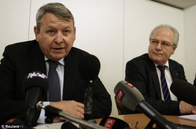 Saddened: Jean-Pierre Gross, left, chief prosecutor of Valais County, speaks beside Robert Steiner, chief of police ad interim, at a news conference in Daillon today