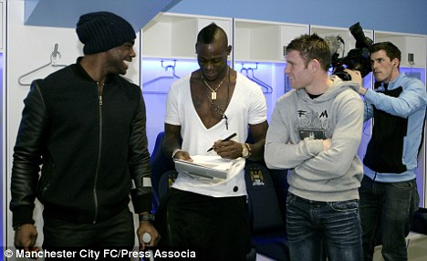 Visit: Micah Richards (left) watched Chelsea face QPR at Stamford Bridge