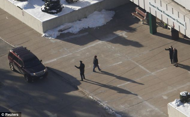 Security: Police officers wait outside the school to welcome students and check parents' IDs