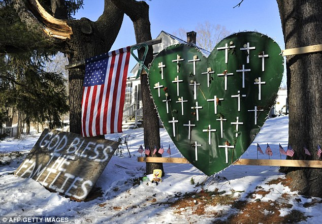 Remembered: Memorial items remain in Newtown, Connecticut on January 3 as students return to school