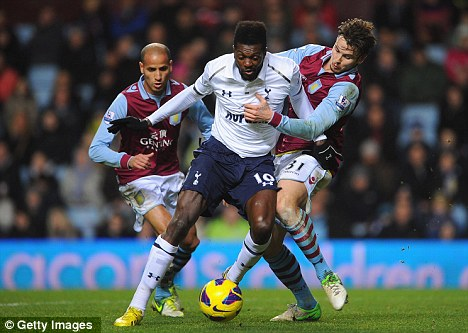 Unsure: Adebayor hasn't yet made his mind up whether he's staying with Tottenham or going to play for Togo