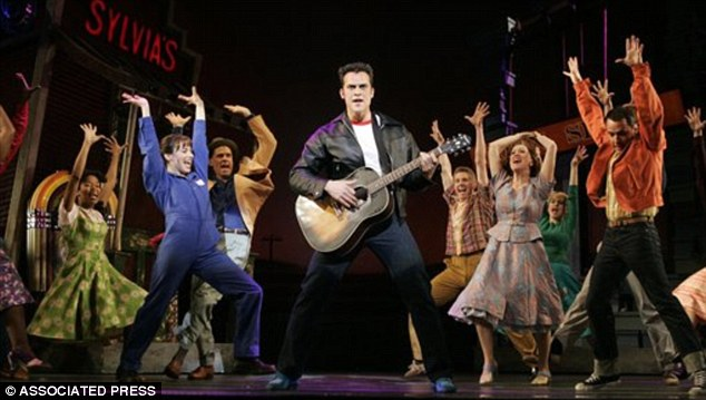 Just a bit of fun: Cheyenne Jackson, (center) in a scene from the original Broadway musical, All Shook Up, which blends elements of Presley's music with Shakespeare's Twelfth Night