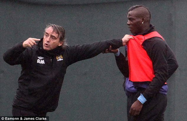 Bust up: Roberto Mancini and Mario Balotelli had yet another arguement during Manchester City training