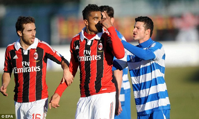 Furious: Kevin-Prince Boateng gestures to the crowd as the AC Milan midfielder leaves the field