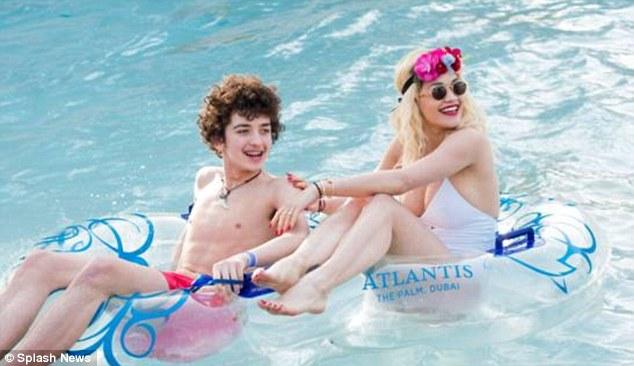 Splashing around: Prior to the public row, Rita was seen enjoying a holiday at the Atlantis Palm hotel in Dubai