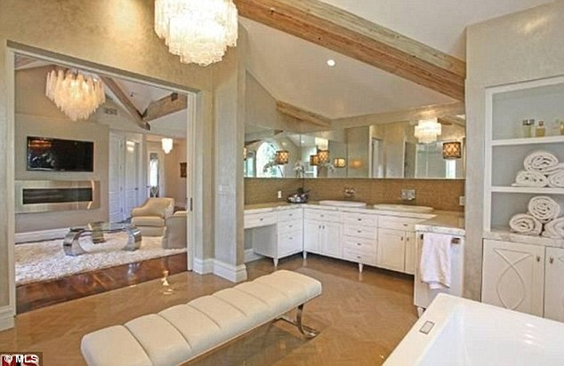 Cool and stately: The master bathroom comes with his and her sinks and lots of cabinet space