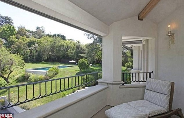 A room with a view: A second-floor balcony offers a marvelous view of pool and well-maintained greenery