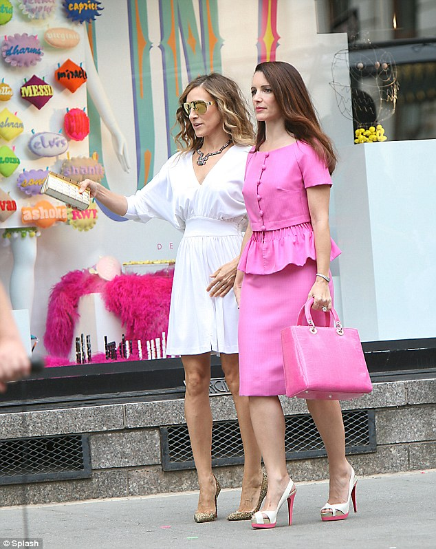 Stunner: Kristin, seen here shooting a scene for Sex and the City 2 with Sarah Jessica Parker, was pretty in peek-a-boo heels and pink frock