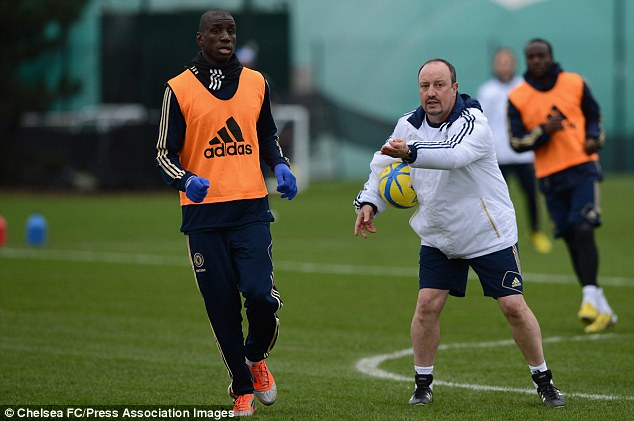 Let's see what you've got: Chelsea boss Rafa Benitez with new recruit Demba Ba in training