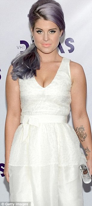 Struggles: Over the years Kelly has battled with her weight but says now is the healthiest she's been