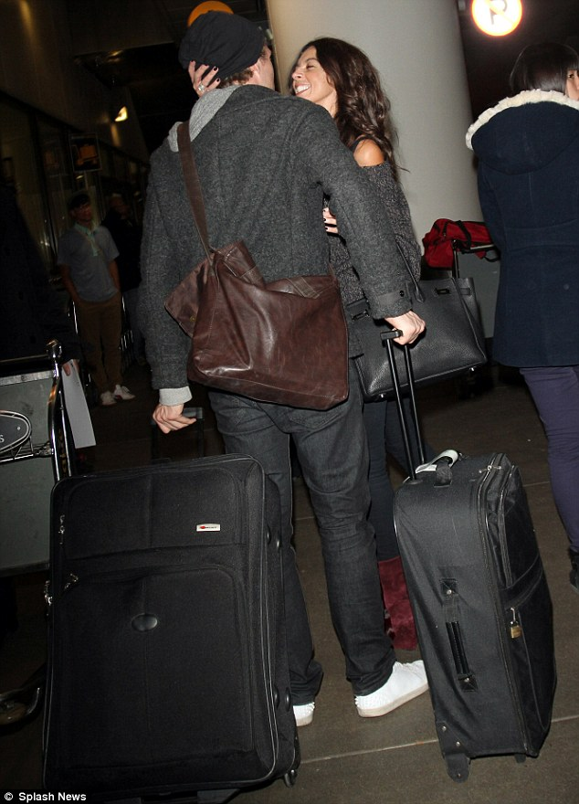 Who's that guy: Terri Seymour puckered up to a mystery man at LAX airport on Friday