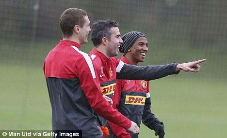 All smiles: Anders Lindegaard praised Manchester United's team spirit