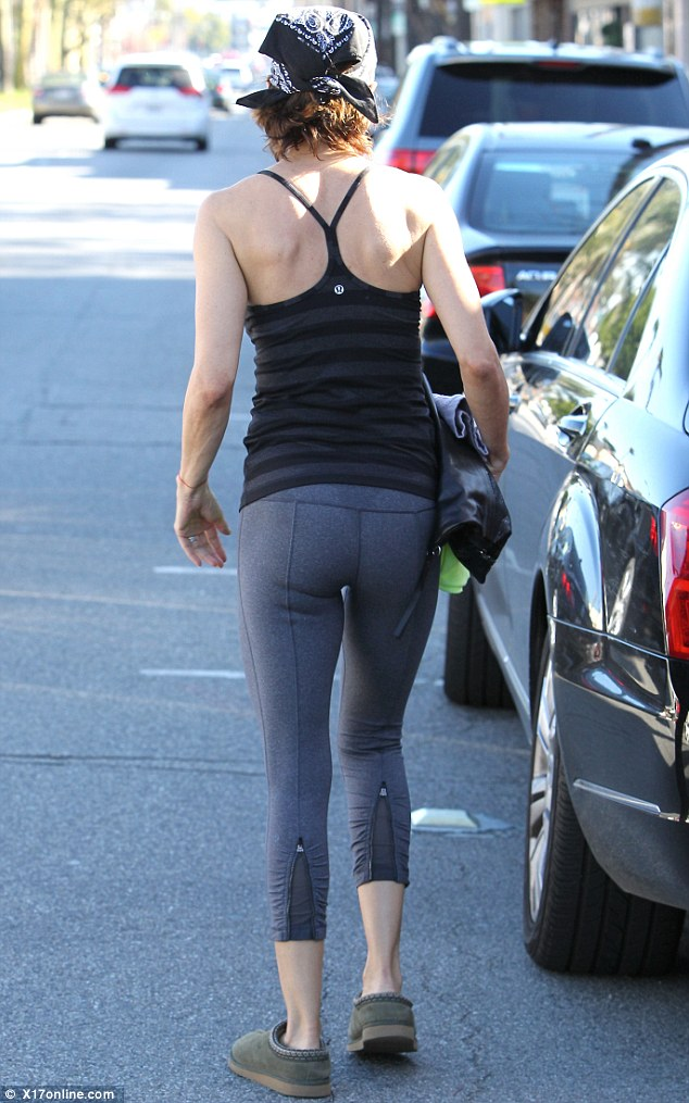 Toned: The 49-year-old star showed off her toned limbs in form-fitting leggings and a striped vest top, the result of her working out four times a week