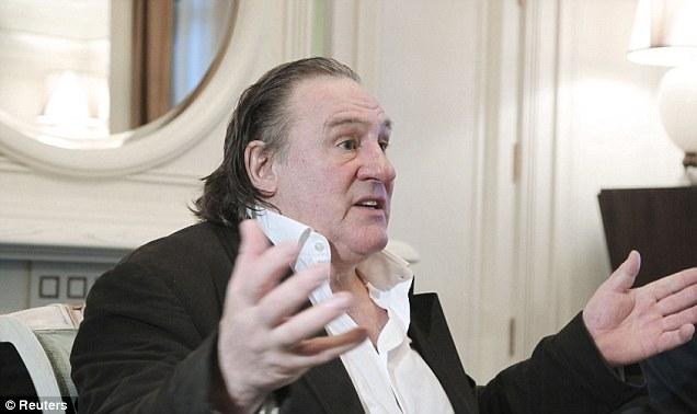 Lively debate: Depardieu gestures during his meeting with Putin