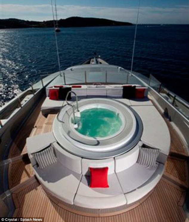 Living the high life: The yacht features a large hot tub on deck, surrounded by a comfy seating area