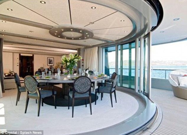 Dining area: The boat features a large dining table with is situated on the deck