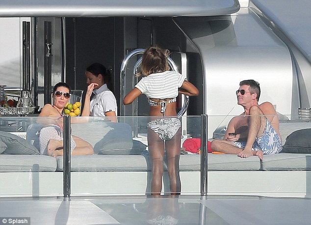 Picking up the bill: According to reports, Simon is footing the bill for all of his friends to spend the holiday with himPicking up the bill: According to reports, Simon is footing the bill for all of his friends to spend the holiday with him