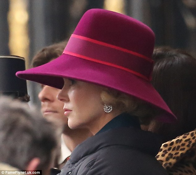 Regal return: Nicole looked amazing in the large fushia hat and pearl earrings - the epitome of grace