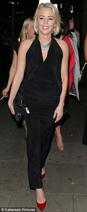 Essex fashionista: Across town, Lydia Bright showed off her fashion credentials in a backless halterneck jumpsuit as she headed to London's Circus bar and club for a friend's birthday