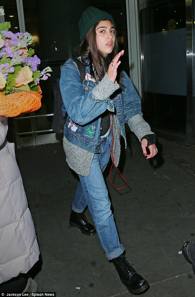 Effortlessly cool: Make-up free Lourdes teamed her denim ensemble with a grey cardigan, knitted hat and boots