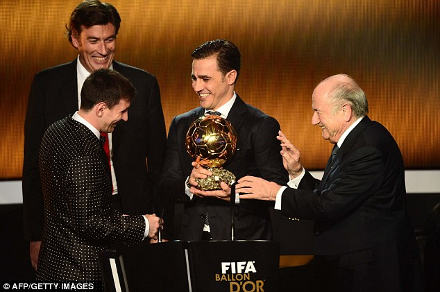 We've been here before! Messi receives the FIFA Ballon d'Or award for the fourth year in a row
