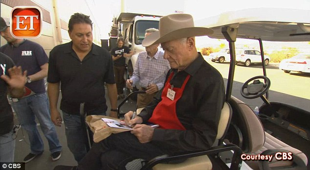 Not forgetting his fans: Hagman signed autographs for fans outside the discount grocer