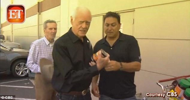 Ready for the job: Hagman gets direction about the barbecue sauce he'll be hawking