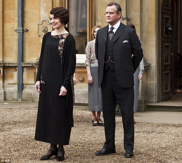 Still keeping on: Elizabeth McGovern as Lady Grantham, Hugh Bonneville as Lord Grantham welcomed nearly 8 million views to the opening episode of Downton Abbey's third series