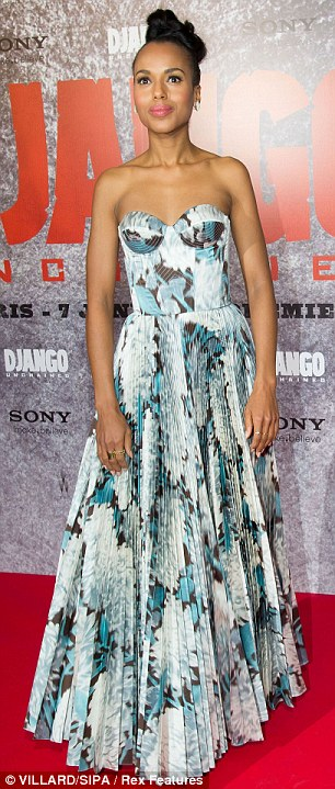 Skin-baring: The star wore a floor-length gown with a bodice incorporated, seen right at the Rome premiere on Friday