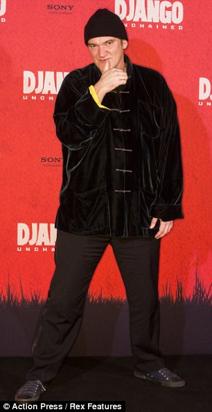 What's he come as? Quentin Tarantino wore an unusual ensemble for the photo call
