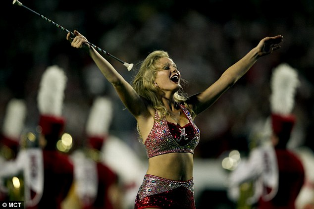 An Alabama band team majorette dances before the team meets Notre Dame in the BCS National Championship game at Sun Life Stadium on Monday