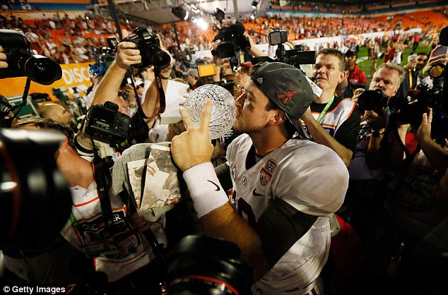 Quarterback AJ McCarron of the Alabama Crimson Tide celebrates with the Coach's Trophy after defeating the Notre Dame Fighting Irish by a score of 42-14 to win the 2013 Discover BCS National Championship