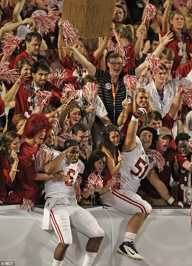 Alabama fans celebrate with HaHa Clinton-Dix (6) and Wilson Love (51) after defeating Notre Dame