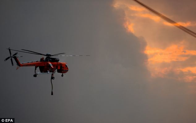 A sky crane water bombing helicopter